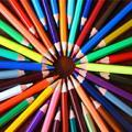 Picture of coloured pencils in a circle on a wooden table