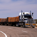 A road train going through Australian bushland