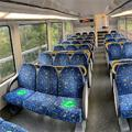 empty train with social distancing stickers